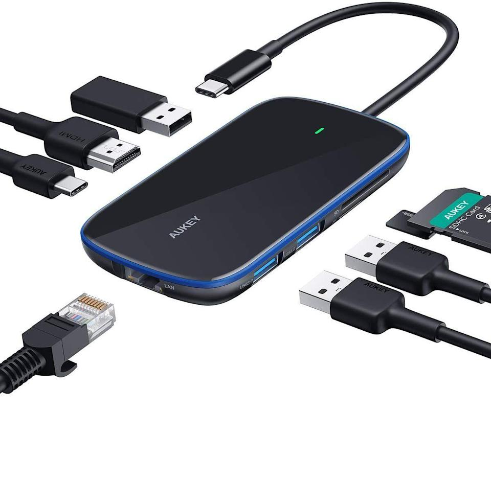 """<p><strong>AUKEY</strong></p><p>amazon.com</p><p><strong>$31.99</strong></p><p><a href=""""https://www.amazon.com/dp/B07RZ3M52P?tag=syn-yahoo-20&ascsubtag=%5Bartid%7C10054.g.34313481%5Bsrc%7Cyahoo-us"""" rel=""""nofollow noopener"""" target=""""_blank"""" data-ylk=""""slk:Buy"""" class=""""link rapid-noclick-resp"""">Buy</a></p><p><strong><del>$39.99</del> (20% off)</strong> </p><p>In case your computer at home is beginning to look like a many-tentacled cord monster.</p>"""