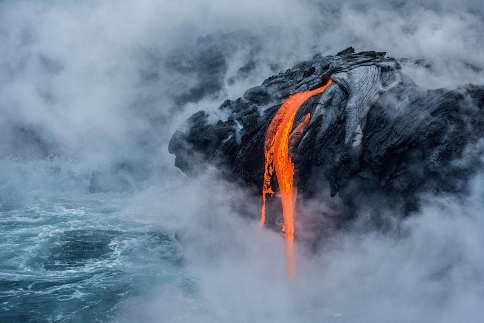 <p>The image shows the 61G lava flow at the Pu'u O'o eruption site of the active Kilauea volcano in Hawaii's Volcano National Park. It was given an honorable mention in the Earth Science and Climatology category. (PA) </p>