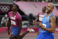 Lamont Jacobs of Italy, right, crosses the finish line to win the men's the 100-meter final besides second placed Fred Kerley of United States at the 2020 Summer Olympics, Sunday, Aug. 1, 2021, in Tokyo, Japan. (AP Photo/Matthias Schrader)