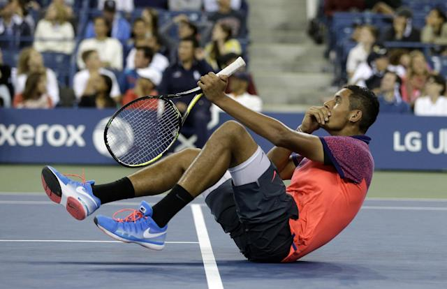 Nick Kyrgios, of Australia, falls back after watching a replay during his match against Tommy Robredo, of Spain,in the third round of the U.S. Open tennis tournament Saturday, Aug. 30, 2014, in New York. (AP Photo/Darron Cummings)