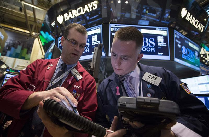 Traders William Lawrence and Justin Flinn work on the floor of the New York Stock Exchange