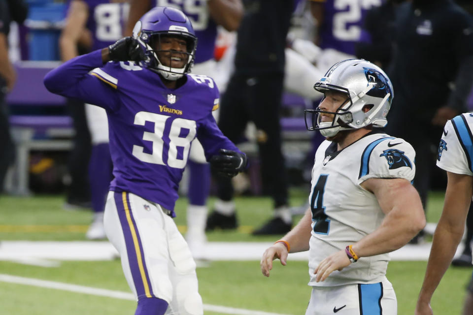 Carolina Panthers place kicker Joey Slye, right, reacts in front of Minnesota Vikings' Harrison Hand, left, after missing a field goal at the end of an NFL football game, Sunday, Nov. 29, 2020, in Minneapolis. The Vikings won 28-27. (AP Photo/Bruce Kluckhohn)