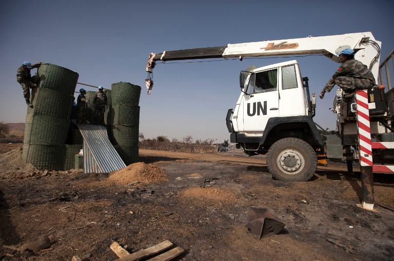 A handout picture released by the United Nations-African Union Mission in Darfur (UNAMID) on April 6, 2014 shows UNAMID engineers working on the construction of a watch tower in the a Buffer Zone in Khor Abeche