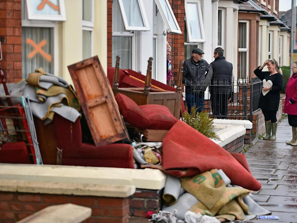 Residents start to empty their possessions from their homes after Storm Desmond caused floodingJeff J Mitchell/Getty Images