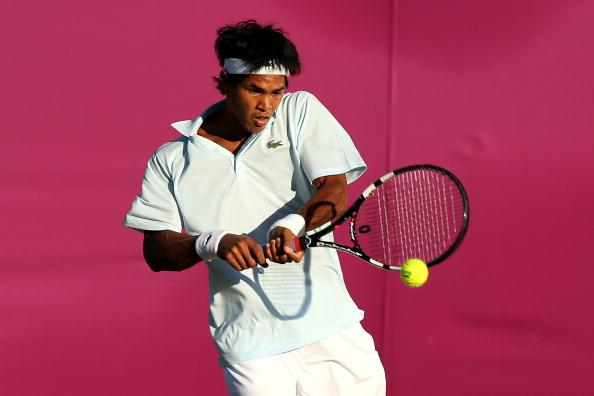 LONDON, ENGLAND - JULY 29:  Somdev Devvarman of India plays a backhand during the Men's Singles Tennis match against Jarkko Nieminen of Finland on Day 2 of the London 2012 Olympic Games at the All England Lawn Tennis and Croquet Club in Wimbledon on July 29, 2012 in London, England.  (Photo by Ezra Shaw/Getty Images)
