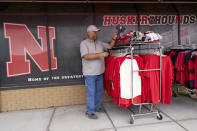 Steve Skradska shops for discounted Nebraska merchandise at the Husker Hounds store in Omaha, Neb., Wednesday, Aug. 12, 2020. The Big Ten conference announced on Tuesday, Aug. 11, 2020, they won't play football this fall because of concerns about COVID-19, becoming the first of college sports' power conferences to yield to the pandemic. (AP Photo/Nati Harnik)