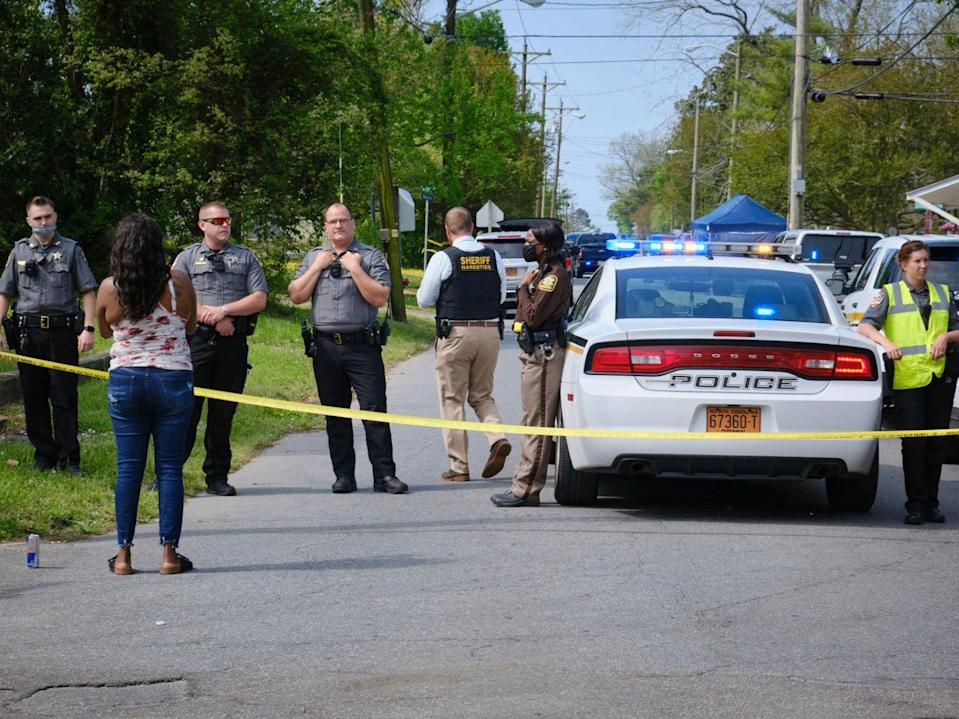 A resident, left, uses her cell phone to record video of police near the scene of a shooting, Wednesday, April 21, 2021 in Elizabeth City, N.C.  (AP)