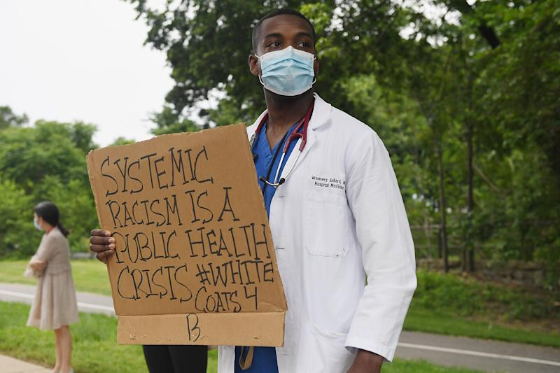 Several hundred doctors, nurses and medical professionals come together to protest police brutality on Friday. (Michael B. Thomas/Getty Images)