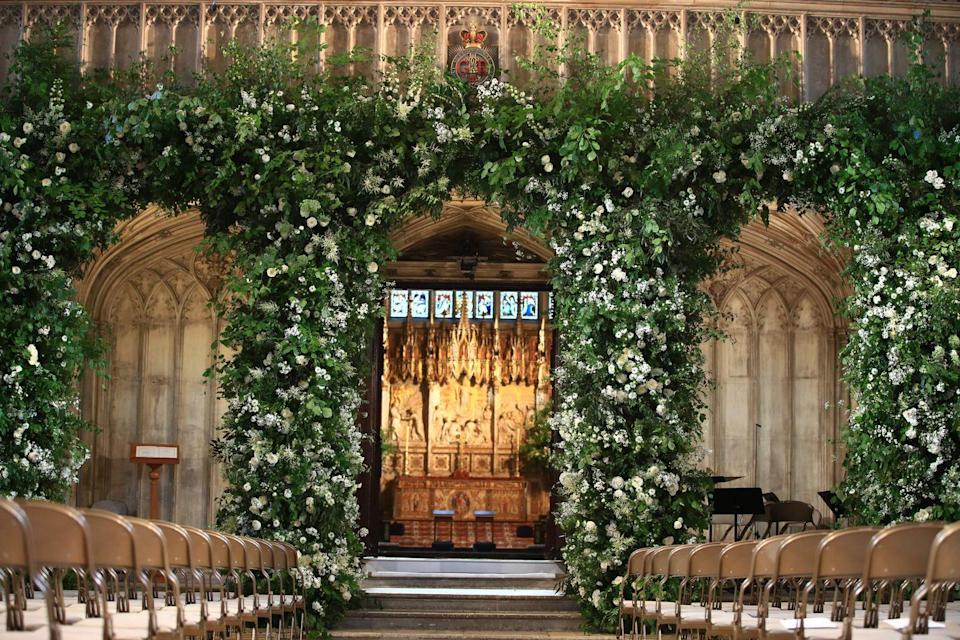 """<p>Their florist Philippa Craddock also selected a neutral color scheme with an emphasis on flowers that bloom naturally during the spring season, such as white garden roses, <span class=""""redactor-unlink"""">peonies</span>, and foxgloves. She also used silver birch and English oak foliage for added greenery in the elaborate archways constructed both outside and inside the chapel.</p>"""