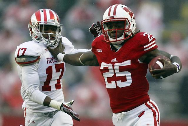 Wisconsin's Melvin Gordon, right, pushes off on Indiana's Michael Hunter during the first half of an NCAA college football game Saturday, Nov. 16, 2013, in Madison, Wis. (AP Photo/Andy Manis)