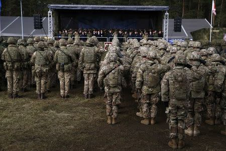 U.S. soldiers attend a welcoming ceremony at polygon near Orzysz, Poland, April 13, 2017. REUTERS/Kacper Pempel