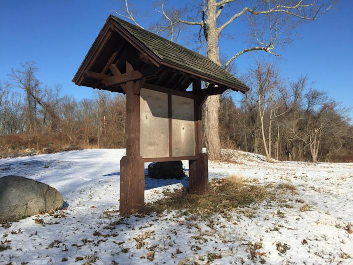 A wooden map kiosk goes unused at the entrance of Donald J. Trump State Park's French Hill section. (Photo: Michael Walsh/Yahoo News)