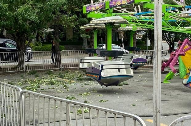 Debris from a tree can be seen on the ground near a carnival ride in Halifax. Jacob Joly said he and his girlfriend hit tree branches while on the ride Wednesday. (Jacob Joly - image credit)