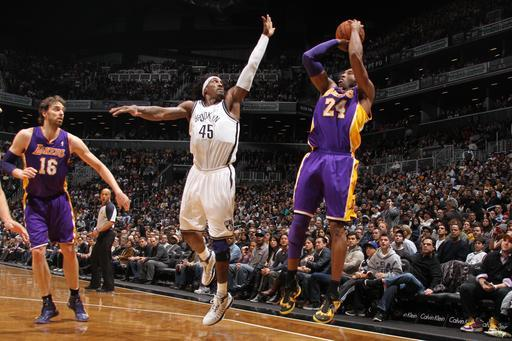 BROOKLYN, NY - FEBRUARY 5: Kobe Bryant #24 of the Los Angeles Lakers shoots against Gerald Wallace #45 of the Brooklyn Nets on February 5, 2013 at the Barclays Center in the Brooklyn borough of New York City. (Photo by Nathaniel S. Butler/NBAE via Getty Images)