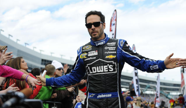 Jimmie Johnson greets fans during driver introductions before the NASCAR Sprint Cup series auto race at Texas Motor Speedway in Fort Worth, Texas, Sunday, Nov. 3, 2013. (AP Photo/Ralph Lauer)