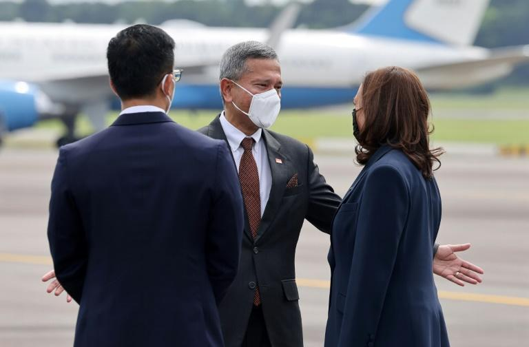 Vice President Kamala Harris was welcomed by Singapore's Minister for Foreign Affairs Vivian Balakrishnan (C)