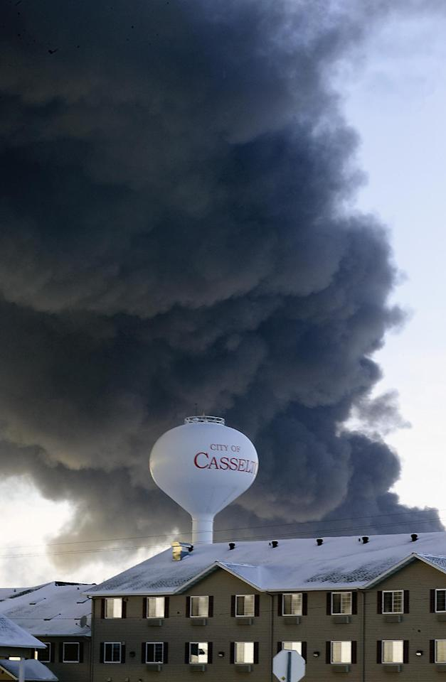 A fireball goes up at the site of an oil train derailment Monday, Dec 30, 2013, in Casselton, N.D. The train carrying crude oil derailed near Casselton Monday afternoon. Several explosions were reported as some cars on the mile-long train caught fire. (AP Photo/Bruce Crummy)
