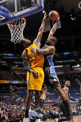 ORLANDO, FL - MARCH 8: Kyle O'Quinn #2 of the Orlando Magic dunks against Ian Mahinmi #28 of the Indiana Pacers on March 8, 2013 at Amway Center in Orlando, Florida. (Photo by Fernando Medina/NBAE via Getty Images)
