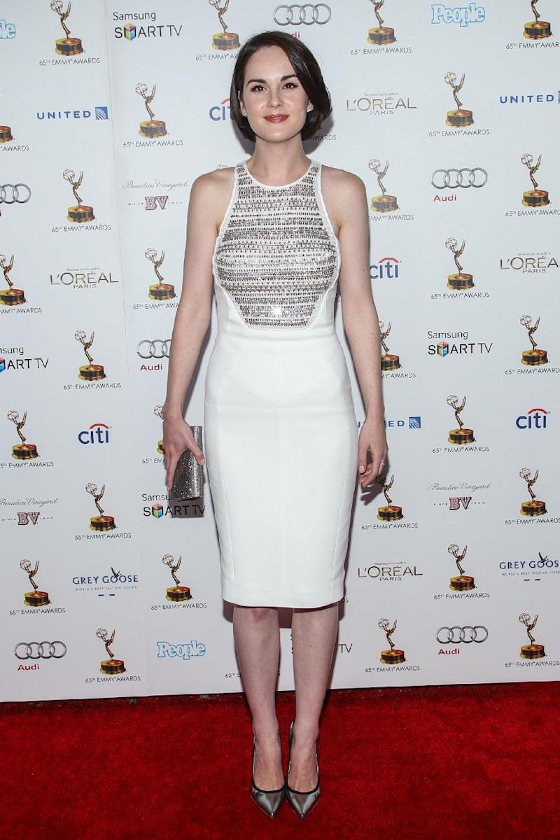 Actress Michelle Dockery arrives at the 65th Primetime Emmy Awards Performers Nominee Reception at the Pacific Design Center on Friday, Sept. 20, 2013 in Los Angeles. (Photo by Paul A. Hebert/Invision/AP)
