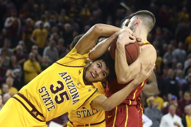 Arizona State forward Taeshon Cherry (35) ties up Southern California forward Nick Rakocevic, right, for a jump ball with possession going to Arizona State during the second half of an NCAA college basketball game Saturday, Feb. 8, 2020, in Tempe, Ariz. Arizona State won 66-64. (AP Photo/Ross D. Franklin)