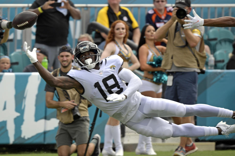 Jacksonville Jaguars wide reciever Laquon Treadwell (18) reaches but can't make the catch on a pass during the first half of an NFL football game against the Denver Broncos, Sunday, Sept. 19, 2021, in Jacksonville, Fla. (AP Photo/Phelan M. Ebenhack)
