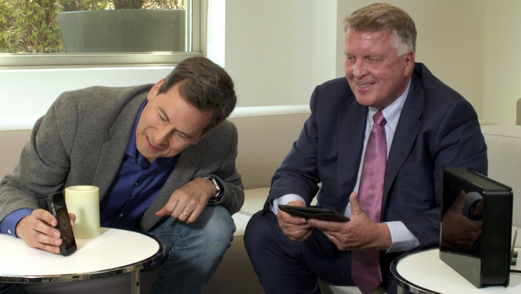 CEO Steve Rizzone (right) shows me through-the-air charging in 2015.