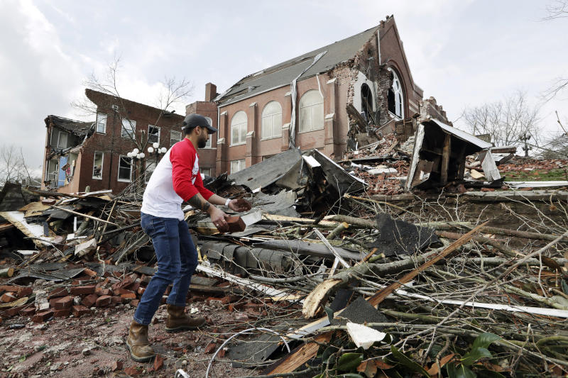 Sumant Joshi helps to clean up rubble at the East End United Methodist Church after it was heavily damaged by storms in Nashville