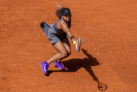 Japan's Naomi Osaka, returns the ball to Japan's Misaki Doi during their match at the Mutua Madrid Open tennis tournament in Madrid, Spain, Friday, April 30, 2021. (AP Photo/Bernat Armangue)