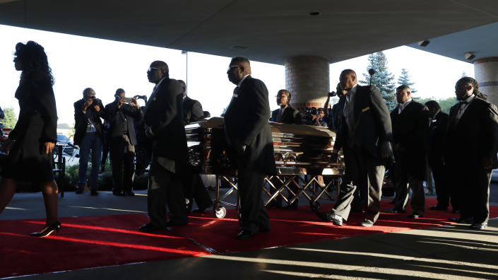 Pallbearers carry the gold casket of legendary singer Aretha Franklin as it arrives at the Greater Grace Temple in Detroit, Friday, Aug. 31, 2018. Franklin died Aug. 16 of pancreatic cancer at the age of 76. (AP Photo/Jeff Roberson)