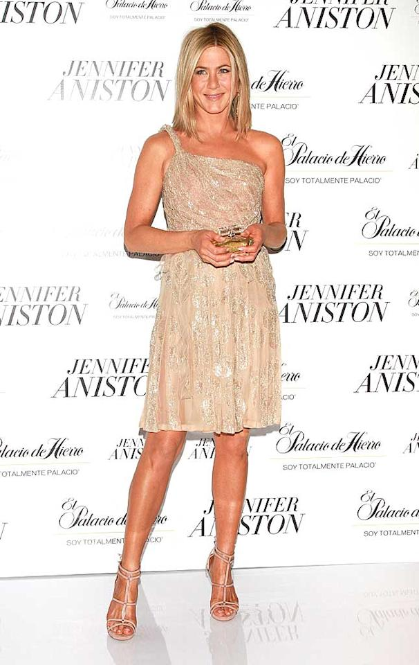 "Jennifer Aniston showed off her perfectly bronzed bod -- in an embellished, one-shoulder Valentino stunner and strappy Tabitha Simmons heels -- while promoting her new fragrance at the St. Regis Hotel in Mexico City, Mexico. Victor Chavez/<a href=""http://www.wireimage.com"" target=""new"">WireImage.com</a> - March 10, 2011"