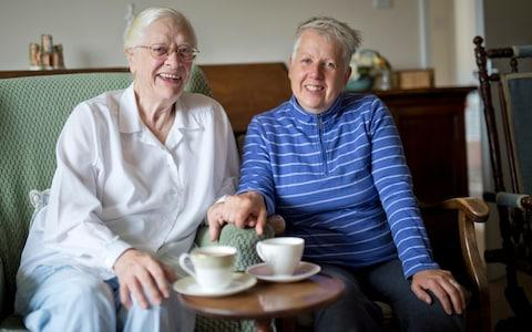Gillian Truslove (white top) with neighbour Sophie Pringle who share a common decendent - Credit: David Rose