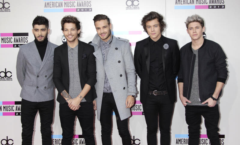 Zayn Malik, Louis Tomlinson, Liam Payne, Harry Styles, and Niall Horan of One Direction arrive at the American Music Awards on November 24, 2013 in Los Angeles, California. Francis Specker /Landov