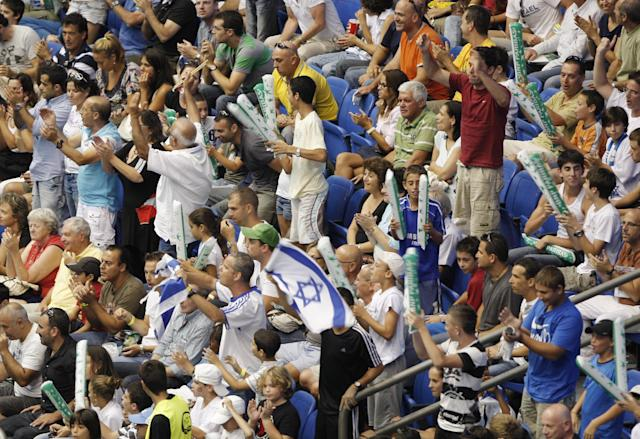 Israeli supporters of the Israel's Davis Cup team cheer during the doubles Davis Cup World Group play-off Tennis Match against Austria's Davis Cup team players Jurgen Melzer, and Alexander Peya, not seen, in Tel Aviv, Israel, Friday, Sept. 17, 2010. (AP Photo/Ariel Schalit)