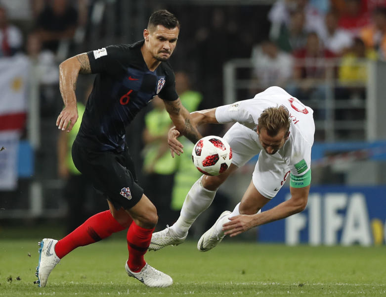 Croatia's Dejan Lovren, left, and England's Harry Kane challenge for the ball during the semifinal match between Croatia and England at the 2018 soccer World Cup in the Luzhniki Stadium in, Moscow, Russia, Wednesday, July 11, 2018. (AP Photo/Alastair Grant)