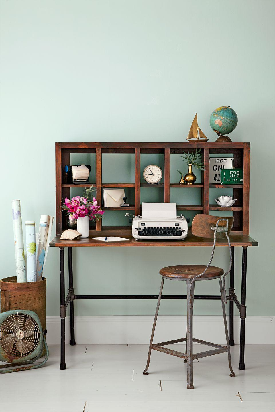 <p>Stack a shoe cubby or DIY floating shelf unit on top of a console table to give it the added perk of storage space. Not only does it look more visually interesting, it'll definitely help you stay organized. </p>