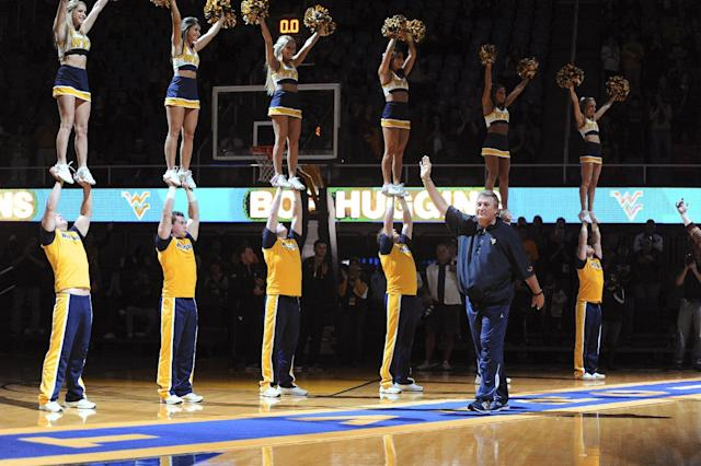 West Virginia coach Bob Huggins is introduced for the NCAA college basketball team's scrimmage, Friday, Oct. 18, 2013, in Morgantown, W.Va. (AP Photo/Andrew Ferguson)