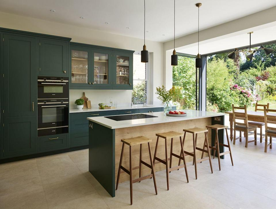 "<p>It's all about the colour green this year. Sage greens will define the contemporary kitchen, while stronger, more traditional tones like forest green will enrich more classical kitchen schemes, explains Simon Bodsworth, Managing Director at <a href=""http://www.daval-furniture.co.uk"" rel=""nofollow noopener"" target=""_blank"" data-ylk=""slk:Daval"" class=""link rapid-noclick-resp"">Daval</a>.</p><p>Use green to bring the outside in, create a connection with nature from the comfort of your own home, and to benefit your mental health and wellness.</p><p>'Green has really become a new neutral,' says Mark Mills, Managing Director at <a href=""https://mereway.co.uk/"" rel=""nofollow noopener"" target=""_blank"" data-ylk=""slk:Mereway Kitchens"" class=""link rapid-noclick-resp"">Mereway Kitchens</a>. 'It works beautifully in both contemporary and traditional kitchens bringing a fresh elegance and energy to the space. Using dark green base units help ground a larger space and can even create a feeling of space in smaller kitchens when matched with ivory or bleached wood wall units.</p><p>'Complete the look with bronze, brass or copper elements for a modern yet timeless feel. Perfect for working the biophilic trend alongside natural textiles, wood flooring, warm blush tone and plenty of fresh herbs!'<br></p><p>Also trending: Greys and midnight blues remain popular in the modern kitchen, but for more statement colours, look towards deep shades of off blacks, aubergine and deep turquoise.</p><p>Pictured: Forest green kitchen, <a href=""https://roundhousedesign.com/"" rel=""nofollow noopener"" target=""_blank"" data-ylk=""slk:Roundhouse"" class=""link rapid-noclick-resp"">Roundhouse</a></p>"
