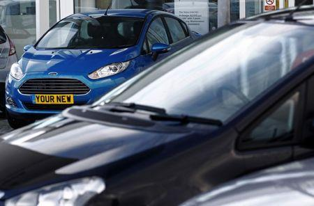 A new car is displayed on the forecourt of a Ford dealership at Portslade near Brighton