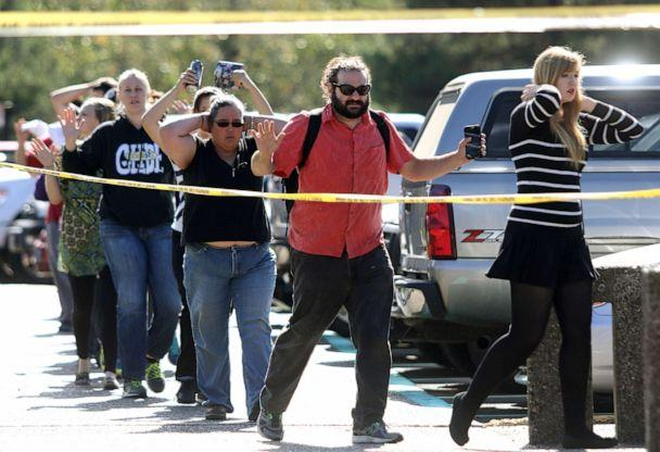 PHOTO: Students, staff and faculty are evacuated from Umpqua Community College in Roseburg, Ore. after a deadly shooting Thursday, Oct. 1, 2015. (Michael Sullivan /The News-Review via AP)