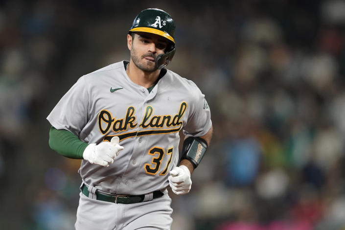 Oakland Athletics' Aramis Garcia runs the bases after he hit solo home run against the Seattle Mariners during the seventh inning of a baseball game Saturday, July 24, 2021, in Seattle. (AP Photo/Ted S. Warren)
