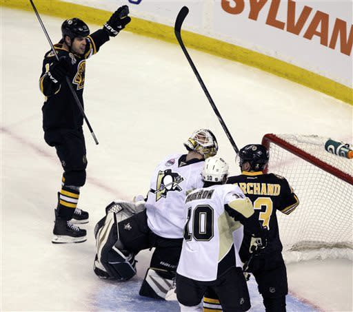 Boston Bruins' Brad Marchand (63) celebrates with teammate Nathan Horton, left, after scoring a goal as Pittsburgh Penguins goalie Tomas Vokoun (92) and Brenden Morrow reacts during the first period of an NHL hockey game, Saturday, April 20, 2013, in Boston. (AP Photo/Mary Schwalm)