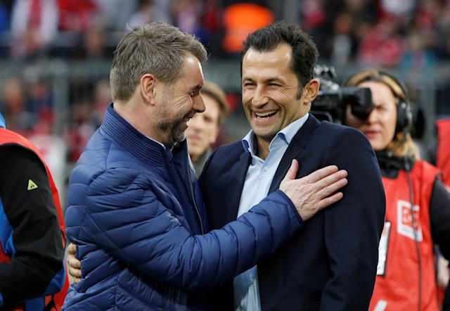 Soccer Football - Bundesliga - Bayern Munich vs Hamburger SV - Allianz Arena, Munich, Germany - March 10, 2018 Hamburg coach Bernd Hollerbach and Bayern Munich Sporting Director Hasan Salihamidzic before the match REUTERS/Michaela Rehle DFL RULES TO LIMIT THE ONLINE USAGE DURING MATCH TIME TO 15 PICTURES PER GAME. IMAGE SEQUENCES TO SIMULATE VIDEO IS NOT ALLOWED AT ANY TIME. FOR FURTHER QUERIES PLEASE CONTACT DFL DIRECTLY AT + 49 69 650050