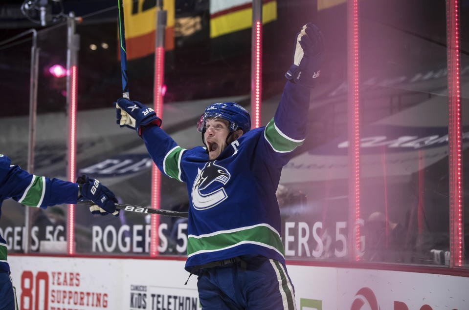 Vancouver Canucks' Bo Horvat celebrates after scoring the winning goal during overtime of an NHL hockey game against the Toronto Maple Leafs in Vancouver, British Columbia, Sunday, April 18, 2021. (Darryl Dyck/The Canadian Press via AP)