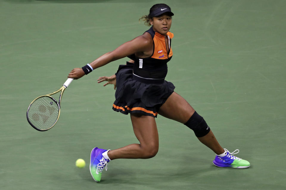 Naomi Osaka, of Japan, returns a shot to Coco Gauff during the third round of the U.S. Open tennis tournament Saturday, Aug. 31, 2019, in New York. (AP Photo/Adam Hunger)