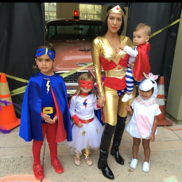 Scary, silly, creepy or cute — send Us Weekly Halloween photos of your families all dressed up to trick-or-treat from October 19 to October 23