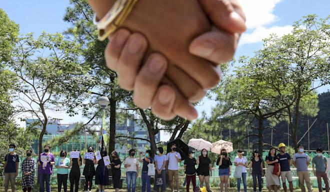 Anti-government protesters and students forming a human chain at Chinese University on Friday. Photo: K.Y. Cheng