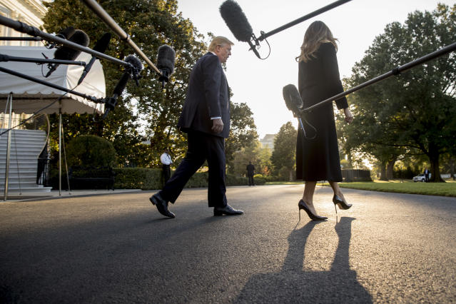<p>President Donald Trump, accompanied by first lady Melania Trump, walks toward Marine One after speaking to reporters on the South Lawn of the White House in Washington, Wednesday, Oct. 4, 2017, for a short trip to Andrews Air Force Base, Md., and then on to Las Vegas to visit with victims and first responders affected by the worst mass shooting in American history. (Photo: Andrew Harnik/AP) </p>