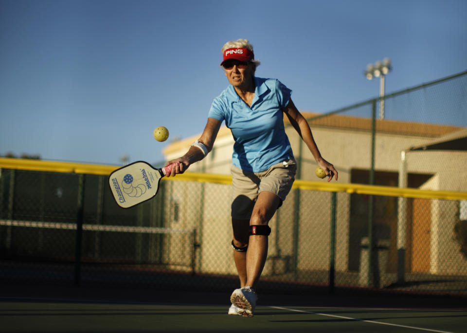 Barb Wald, 66, plays pickleball in Sun City, Arizona, January 5, 2013. Sun City was built in 1959 by entrepreneur Del Webb as America?s first active retirement community for the over-55's. Del Webb predicted that retirees would flock to a community where they were given more than just a house with a rocking chair in which to sit and wait to die. Today?s residents keep their minds and bodies active by socializing at over 120 clubs with activities such as square dancing, ceramics, roller skating, computers, cheerleading, racquetball and yoga. There are 38,500 residents in the community with an average age 72.4 years. Picture taken January 5, 2013.  REUTERS/Lucy Nicholson (UNITED STATES - Tags: SOCIETY)  ATTENTION EDITORS - PICTURE 12 OF 30 FOR PACKAGE 'THE SPORTY SENIORS OF SUN CITY' SEARCH 'SUN CITY' FOR ALL IMAGES