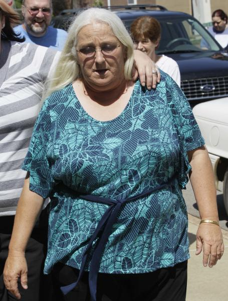 Sharon Jones, center, who cashed a winning lottery ticket after taking it from a bin of discarded tickets July 15, 2011, at a Beebe, Ark., convenience store, walks to a court house during a break in a trial in Searcy, Ark., Tuesday, May 1, 2012. (AP Photo/Danny Johnston)