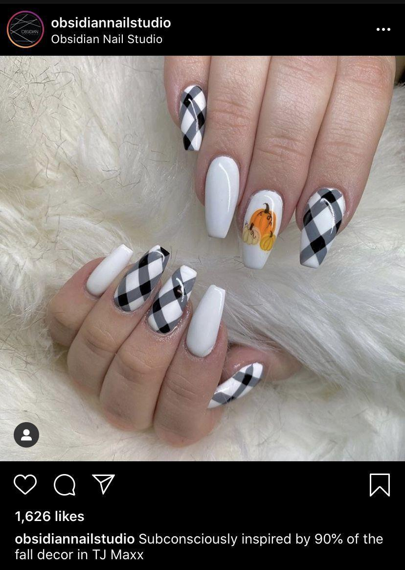 """<p>This manicure, done by the <a href=""""https://www.instagram.com/p/CEHbtZBjEde/"""" rel=""""nofollow noopener"""" target=""""_blank"""" data-ylk=""""slk:Obsidian Nail Studio"""" class=""""link rapid-noclick-resp"""">Obsidian Nail Studio</a>, is the best of fall decor while the pumpkin patch accent adds a subtle nod to Halloween.</p><p><a class=""""link rapid-noclick-resp"""" href=""""https://go.redirectingat.com?id=74968X1596630&url=https%3A%2F%2Fwww.etsy.com%2Flisting%2F935722925%2Fgingham-black-with-white-color-nail&sref=https%3A%2F%2Fwww.oprahdaily.com%2Fbeauty%2Fskin-makeup%2Fg33239588%2Fhalloween-nail-ideas%2F"""" rel=""""nofollow noopener"""" target=""""_blank"""" data-ylk=""""slk:SHOP GINGHAM NAIL WRAPS"""">SHOP GINGHAM NAIL WRAPS</a></p>"""